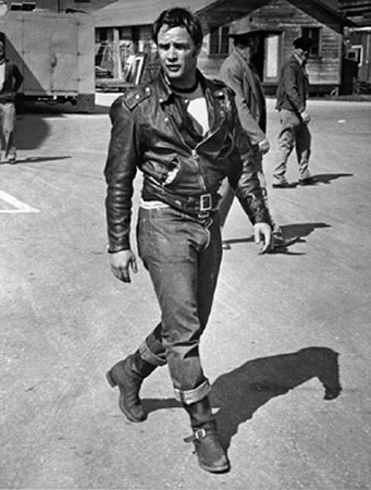 Marlon Brando in jeans and leather jacket.