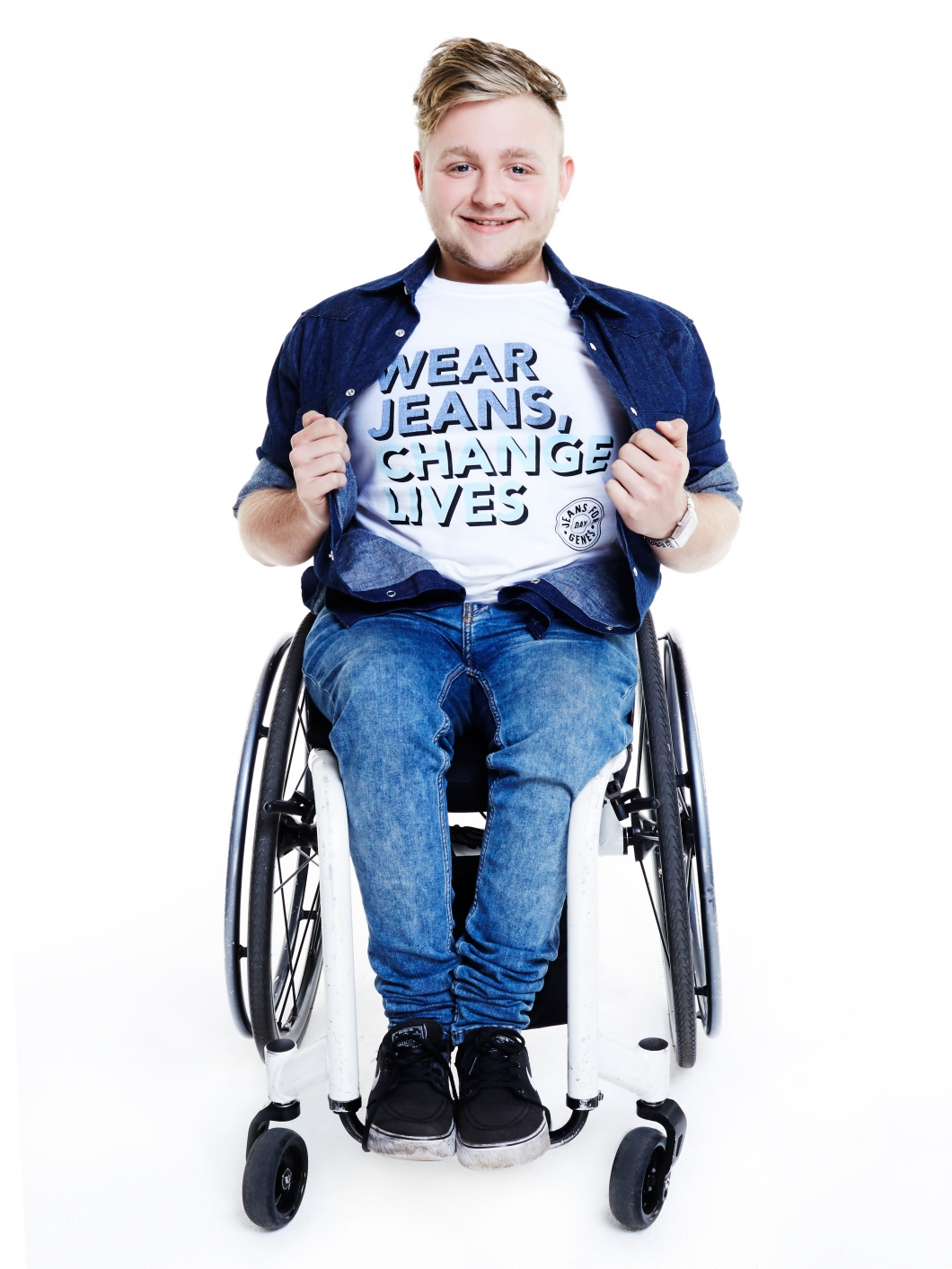 Jack Binstead in Jeans for Genes white campaign t-shirt and denim shirt